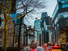 Traffic Flow (Explore, December 19) (Mildred Alpern) Tags: nyc broadway city bus taxi cars buildings lights tree dusk branches reflections windows apartments billboard decorations streetsigns