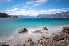 Blue Water - Lake Hawea, New Zealand (www.caseyhphoto.com) Tags: newzealand blue water lake hawea rocks rock mountain mountains sky cielo nubes clouds agua nikon nikkor d800 wideangle 1635f40 nd ndfilter neutral density filter slow shutter speed long exposure casey herx herd photography photographer artist travel traveler traveller traveling travels traveled adventure adventurer adventuring explore explorer exploring tourism tourist wanderlust vacation holiday discover discovering shore nature natural wilderness rural landscape southisland aotearoa south pacific