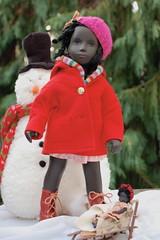 Isabel's Kwanzaa Doll (Emily1957) Tags: isabel kwanzaa blackdoll sashadolls sashadoll cora vintage vintagecora antiquebisquebabydoll sled winter snow sashamorgenthaler earlyenglishsashadoll light naturallight nikond40 nikon kitlens availablelight red