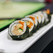 Sushi rolls with tuna, carrot and cucumber. Close up.jpg