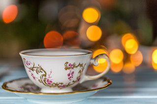 Empty Tea Cup on Saucer On Wood
