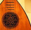 Music of the Season (studioferullo) Tags: art beauty bright colorful colourful colors colours contrast dark design detail edge light perspective pattern pretty study texture tone world arizona phoenix museum music instrument lute guitar wood lines curve circle string carve tune mim