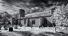 Round tower (David Feuerhelm) Tags: blackandwhite monochrome bw noiretblanc schwarzundweiss contrast wideangle church churchyard tower flag windows graves gravestones tree sky clouds bungay norfolk old history historic infrared ir
