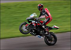 ag17 24102b (Phil Newell) Tags: bikeracing kawasaki racer racing wales wirral100 wirralhundred wheelie 241 thomas ogrady