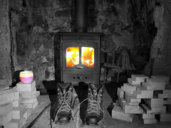 cosy night in by firelight (jeff.dugmore) Tags: england uk europe boots fire tideswell peakdistrict whitepeak derbyshire peakdistrictnationalpark nationalpark christmas christmasnight holiday vacation wood candle logburner pink orange blackwhite wakiing hike iron fuel muddyboots wetboots olympus flames black white colour fireplace cosy welcoming markeygatecottage