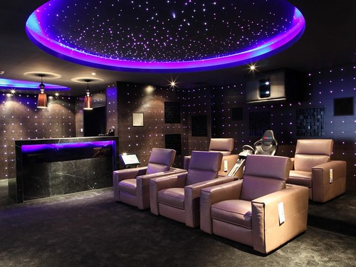 small-home-theater-ideas-big-screen-on-the-beige-wall-long-table-bar-interior-brown-fabric-sofas-red-color-curve-shape-sofas-two-white-sofa-chair