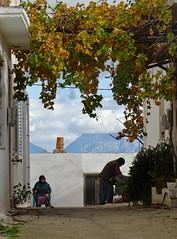 The supervisor and her worker. (Ia Löfquist) Tags: crete kreta alley gränd village by house hus woman kvinna man