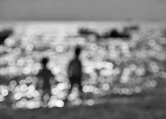 Let me be the one that shines with you (Mister Blur) Tags: slideaway chasingthesun shinewithyou bokeh dots blur sea desenfoque borroso blackandwhite bw blancoynegro rivieramaya playadelcarmen beach scene boys oasis nikon d7100