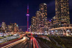 Next Depot: Toronto (TIA International Photography) Tags: toronto ontario canada building bathurst streetbridge cn tower skyscraper condo condominium landmark night evening illumination urban landscape street bridge city cityscape iceboat terrace footbridge puentedeluz francisco gazitua pedestrian railroad railway train light trails motion blur transportation tracks yard rail financial district downtown tia tosinarasi ©tiainternationalphotography