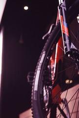Narrow (Yosh the Fishhead) Tags: olympus olympusom olympusom2n om2 om2n olympusom2 film filmphotography fujifilm fujichrome velvia velvia100 fujichromevelvia100 slide slidefilm zuiko macro zuikomacro zuikoautomacro50mmf35 zuikomacro50mmf35 50mm dof wheel bike bicycle bokeh