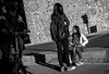 Smiling in the Sun (damar47) Tags: streetphotography streetlife monochromatic monochrome blackwhite blackandwhite biancoenero smile smiling pentaxart k30 pentax streetview girl strangers italian italy italia florence firenze