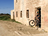 Making an Exit (Gee & Kay Webb) Tags: mtb mountainbike bike bicycle cycling riding fortcampbell malta buildings sky