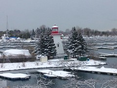 """The very fact of snow is such an amazement.""  - Roger Ebert (Trinimusic2008 - stay blessed) Tags: trinimusic2008 judymeikle nature lighthouse trees sailboats marina lake humberbaymarina snow today snowy december 2017 toronto to ontario canada iphone"