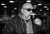 Sunglasses and Guinness. (CWhatPhotos) Tags: cwhatphotos sunglasses shades portrait pose black white mono monochrome me man male drinking ale goatee beard tint side view face pint guinness glass pub inn bar drink l olympus em10 ii lens pictures picture photographs photograph pic pics foto fotos image images with that have which contain