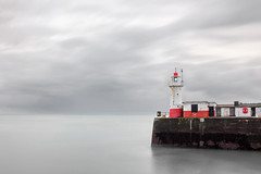 Bleak Outlook, Newlyn (Andrew Hocking Photography) Tags: newlyn cornwall lighthouse dull overcast grey sky harbour wall red longexposure breakwater gloomy morning newyearseve acolour