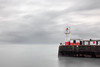 Bleak Outlook, Newlyn (Andrew Hocking Photography) Tags: newlyn cornwall lighthouse dull overcast grey sky harbour wall red longexposure breakwater gloomy morning newyearseve