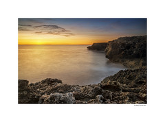 Sunrise colors (g.femenias) Tags: calamorlanda sillot manacor mallorca sunrise seascape landscape rocks sea sun nature colors warmth textures contrast nisicircularpolarizer nisisoftgnd