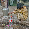crushed (Pejasar) Tags: dalit lowcaste oppressed poor poverty foot injured water coke bottle reuse dirty clothing unkept hair boy child beggar olddelhi india silverbucket waterfaucet crushed weight barefoot