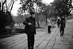 Old town residents: tourist (sailwings) Tags: blackandwhite streetphotography street china