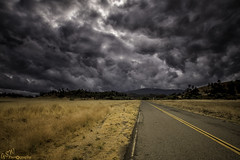 Heading into Trouble (Gavmonster) Tags: gswphotography nikon d7500 nikond7500 us unitedstates america california pacificcoasthighway clouds storm darkskies field road tarmac yellowlines shoulder hills trees turbulent sky contrast