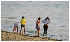 Serching the Water (HereInVancouver) Tags: girls water ocean pacific englishbay beach searching vancouverswestend thingstodobythewater vancouver bc canada englishbaybeach candid canong3x