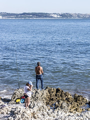 Lisbon 2017: Fishing couple (mdiepraam) Tags: lisbon 2017 portugal people fisherman water river tagus tejo man woman rocks