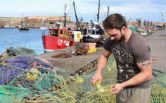 Repairing fishing nets at Dunbar Harbour, Scotland (Baz Richardson (catching up again!)) Tags: scotland dunbar harbours fishermen repairingfishingnets