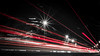 The Ride (Raphael Images) Tags: street ride drive night lights trails long exposure cars black white red accent color noir nikon