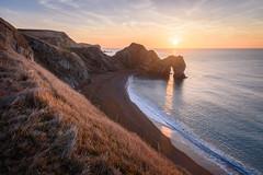 Sunlight Through Durdle Door (Stu Meech) Tags: durdle door sunlight sun through arch sunrise sea stu meech dorset nikon d750 1635