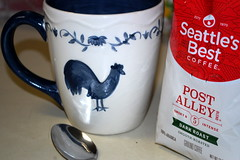 Morning Coffee. (dccradio) Tags: lumberton nc northcarolina robesoncounty indoors inside seattlesbest coffee darkroast spoon coffeecup mug chicken hen rooster blue white drink counter morning goodmorning kitchen kitchencounter flickrfriday coffeebreak nikon d40 dslr arabicacoffee groundcoffee ground