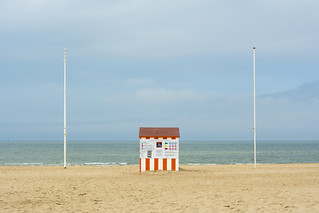 Beach hut with orange stripes