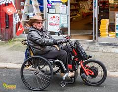 Traveller - Peel, Isle of Man. UK (3.3 mil views - Thank you all.) Tags: staneastwood peel isleofman im stanleyeastwood ocean building architecture bike trike wheelchair people hat cowboy