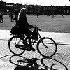 Woman on bicycle.  Museumplein, Amsterdam. (Andy Ziegler) Tags: woman blonde amsterdam bicycle transportation shadows silhouette highkey contrast shape museumplein brick canon6d square movement dutch style travel europe blackwhitephotos