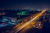 Night Avenue with cars passing through the city with frozen lights (ivan_volchek) Tags: city cityscape traffic architecture dusk travel visiting road skyline evening building urban illuminated bridge highway skyscraper sky river light cars