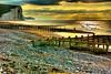 The Beach (Geoff Henson) Tags: dawn daybreak sunrise clouds cliffs beach pebbles breakwater chalk grass water sea ocean waves photographers ghosts