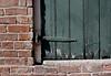 Brick and Mortar (skipmoore) Tags: brick shutter peeling