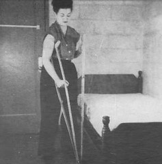 bed07 Fully braced polio girl getting off her bed (jackcast2015) Tags: handicapped disabledwoman crippledwoman paralysed poliogirl legbraces calipers polio poliowoman crutches infantileparalysis wheelchair