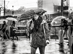the.downpour.part.VII (grizzleur) Tags: olymplus omd olympusomdem5mkii omdstreetphotography bw mono monochrome blackandwhite street photography candid olylove rain raining downpour girl umbrella heavy gully washerr pretty beautiful candidstreetphotography highcontrast contrast wet pouring kit lens kitlenslosers