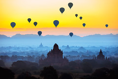 Beautiful sunrise and hot air balloons over ancient pagoda in Bagan is old kingdom in past, Myanmar (Patrick Foto ;)) Tags: air ancient architecture asian attraction bagan balloon ballooning beautiful buddha buddhism buddhist building burma burmese culture dawn destination famous fog heritage historical history hot hotair landmark landscape mandalay mist morning myanmar mystery nature outdoor pagoda religion sanctuary scenery scenic silhouette sky spiritual spirituality stupa summer sunrise sunset temple tour tourism traditional travel twilight vacation view nyaungu mandalayregion myanmarburma mm