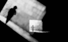 Twilight Zone I (ThorstenKoch) Tags: street streetphotography schatten stadt strasse shadow silhouette schwarzweiss sonne doubleexposure licht lights lines linien light scary unscharf unreal blackwhite bnw monochrome man door outdoor art architecture architektur alone fineart bnwart twilightzone twilight