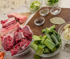 Beef broth mise en place. (annick vanderschelden) Tags: beef broth beefbroth miseenplace ingredients carrots chopped bowl glass cubes bones leek greens onions black peppercorns bayleaf salt driedthyme parsley stems celery belgium