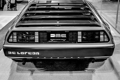 DeLorean Back (FitzJohnson) Tags: deloren future carshow car carphotography canon canonrebel t3i 600d wheels taillights centurylink centurylinkcenteromaha monochrome monochromatic blackandwhite bw blackwhite classic classiccar