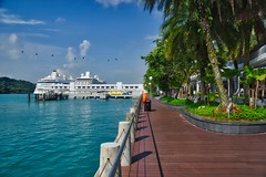 Promenade in front of Vivo City with cruise ship and ferry terminal in Singapore (UweBKK (α 77 on )) Tags: promenade walk vivo city urban cruise ship ferry terminal harbour harbor water blue sky trees green singapore southeast asia sony alpha 77 slt dslr