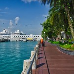 Promenade in front of Vivo City with cruise ship and ferry terminal in Singapore thumbnail