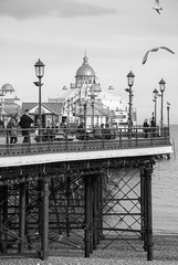 Eastbourne (marktmcn) Tags: eastbourne pier east sussex england victorian structure seaside coast coastal domes lamps sea gulls seagulls people shingle beach blackandwhite monochrome d80 nikkor 18135mm