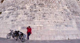 Photographer by the city walls