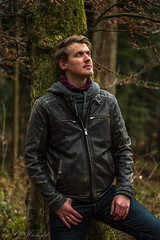 Shooting in the Forest (Aroundniceplaces) Tags: attraktiveyoung shooting forest male blonde german switzerland luzern kriens jacket model green vegetation tree trees posing jeans pullover portrait daytime day natural light