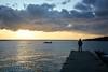 Uomo di mare - Sea man. (sinetempore) Tags: mare sea ionio salento puglia nuvole clouds uomo man street tramonto sunset banchina quay portocesareo sole sun silhouette uomodimare seaman