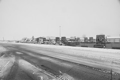 Waiting Trucks (kendoman26) Tags: winter storm snow snowstorm truck happymonochromemonday nikon nikond7100 niksoftware niksilverefexpro2 tokinaatx1228prodx tokina tokina1228 monochrome blackandwhite