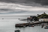 Harbouring no ills (The Frustrated Photog (Anthony) ADPphotography) Tags: architecture category external harbourbeach pembrokeshire places seascape tenby tenbycastle tenbyharbour travel wales travelphotography landscapephotography landscape sea water clouds ripples boats harbour marina seawall town houses coast coastline coastal lifeboatstation greyclouds cloudysky canon1585mm canon70d canon outdoor boat sky